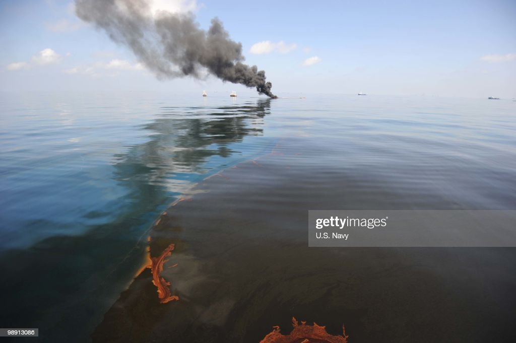 Oil burns during a controlled fire May 6, 2010 in the Gulf of Mexico. The U.S. Coast Guard is overseeing oil burns after the sinking, and subsequent massive oil leak, from the sinking of the Deepwater Horizon oil platform off the coast of Louisiana.