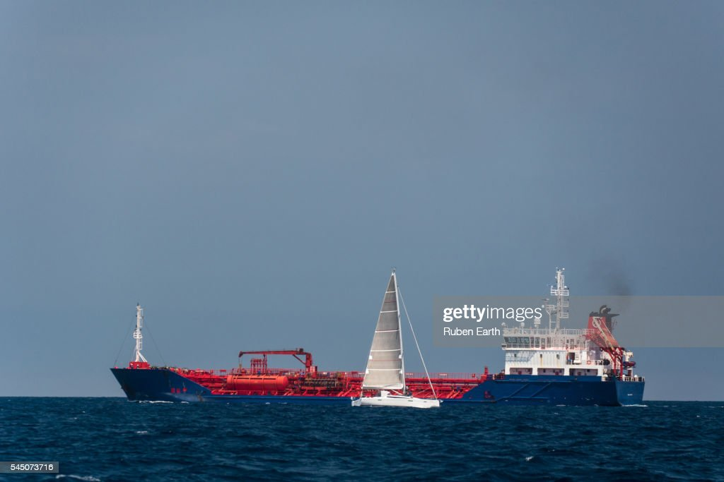 Oil Chemical tanker and sailboat : Stock Photo