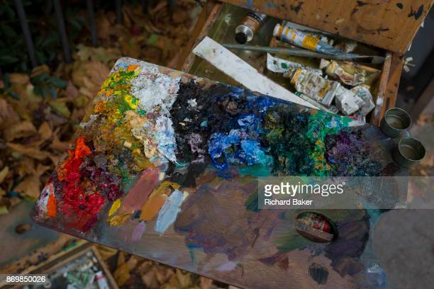 Oil colour paints belonging to a member of the Dulwich Art Group who is painting an autumn landscape on Denmark Hill on 2nd October 2017 in the south...