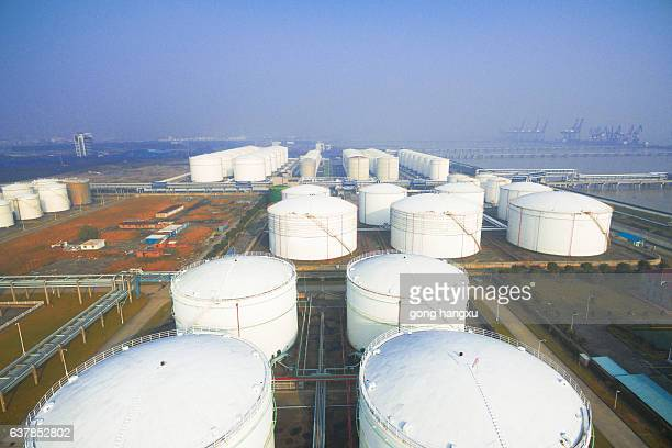oil containers in modern refinery plant in blue sky - storage tank stock photos and pictures