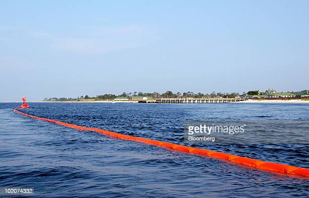 Oil containment boom floats in Pensacola Bay offshore of Fort Pickens State Park near Pensacola Florida US on Sunday June 13 2010 BP Plc sent a...