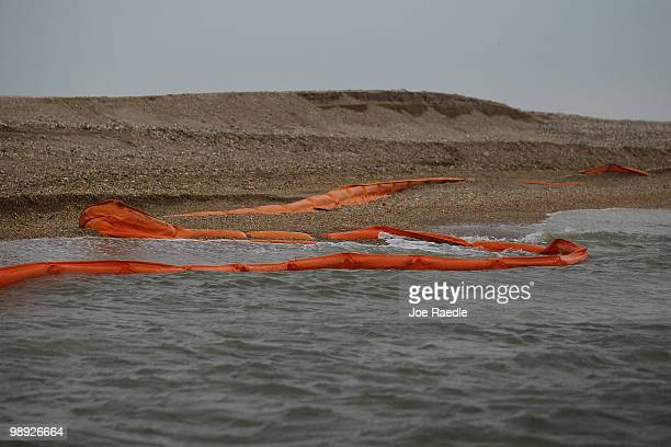 Oil containment booms are seen washed on shore on May 8 2010 in Freemason Island Louisiana Work continues to stop the oil that is still leaking out...
