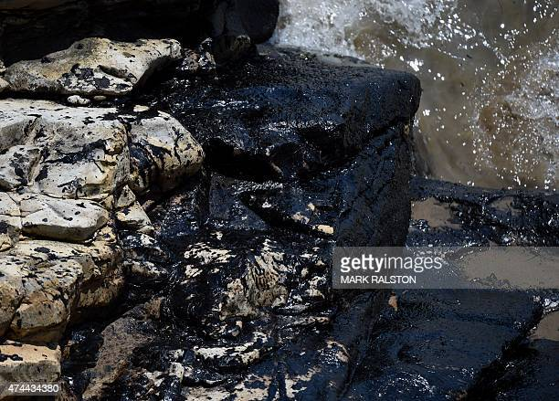 Oil covered rocks at Refugio State Beach in Goleta California May 22 2015 The oil company behind a crude spill on the California coast vowed to do...