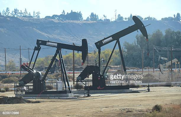 Oil derricks at the Chevron Oil Field in Bakersfield California on November 21 2016 With an economy heavily linked to agriculture and petroleum...