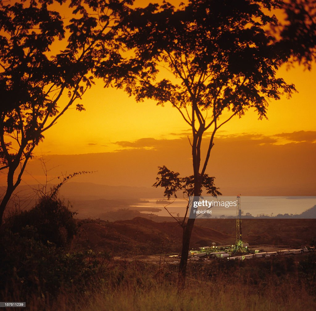 oil drilling at sunset : Stock Photo