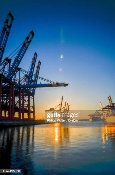 oil drills in sea against dramatic sky during sunset - construction platform stock photos and pictures