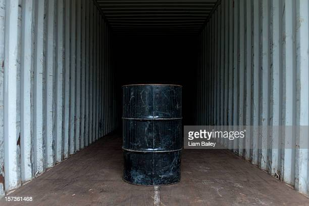 Oil drum in an empty shipping container