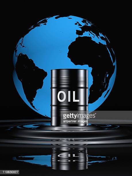 Oil drum in front of a black globe