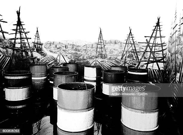 oil drums against clear sky - oil barrel stock pictures, royalty-free photos & images