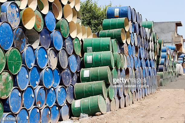 oil drums in industry during sunny day - oil barrel stock pictures, royalty-free photos & images