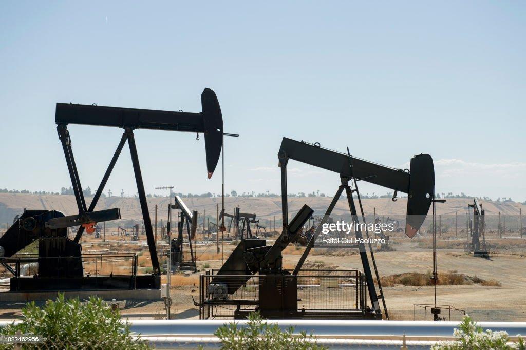 Oil field and Oil Pump near Bakersfield, California, USA : Stock Photo