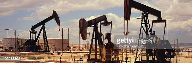 oil field with drilling rigs and storage tanks - timothy hearsum ストックフォトと画像
