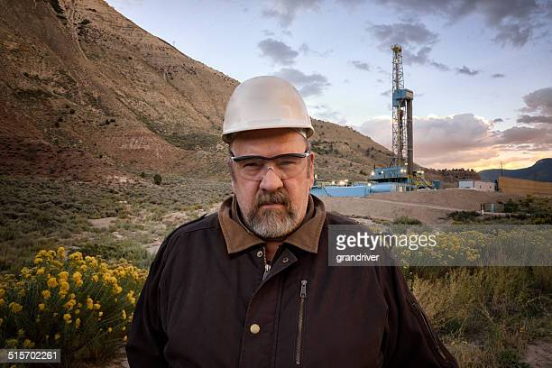 Oil Field Worker and Drill Rig