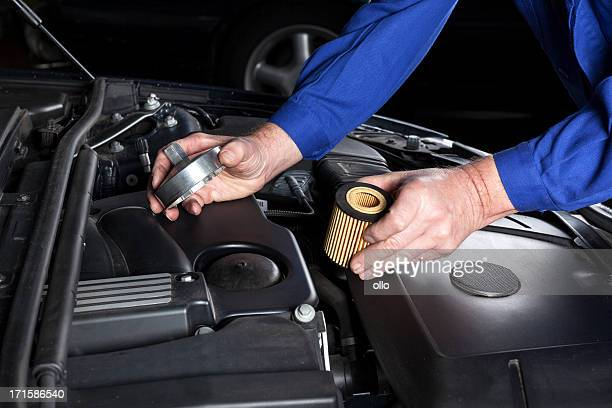 oil filter change - oil change stock pictures, royalty-free photos & images