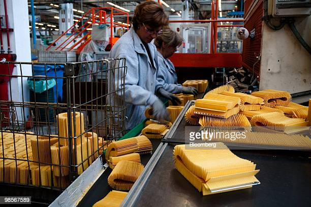 Oil filters made for Alfa Romeo Mito automobiles pass down a conveyor belt at the Tecnocar car parts factory operated by Sogefi SpA near Turin Italy...