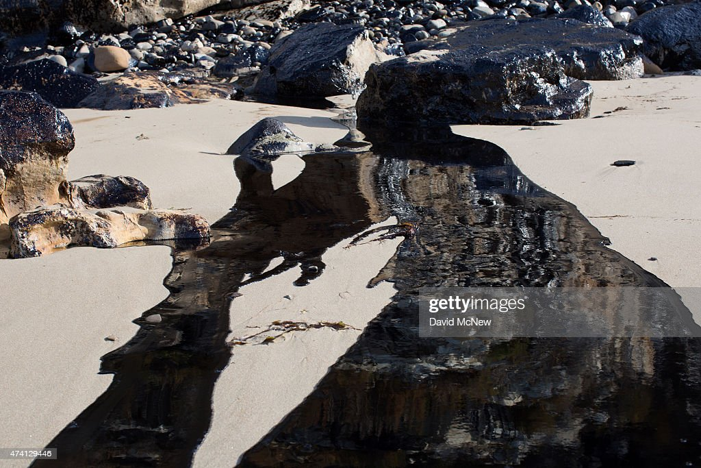 Oil flows toward the ocean from an inland oil spill near Refugio State Beach on May 20, 2015 north of Goleta, California. About 21,000 gallons spilled from an abandoned pipeline on the land near Refugio State Beach, spreading over about four miles of beach within hours. The largest oil spill ever in U.S. waters at the time occurred in the same section of the coast where numerous offshore oil platforms can be seen, giving birth to the modern American environmental movement.