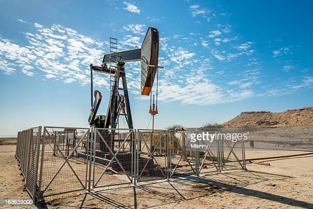 oil industry nodding donkey well pumps - gulf countries stock pictures, royalty-free photos & images