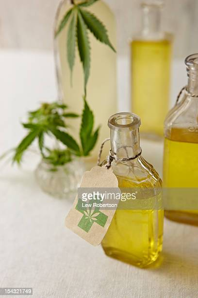 oil infused with marijuana - cannabis oil stock photos and pictures