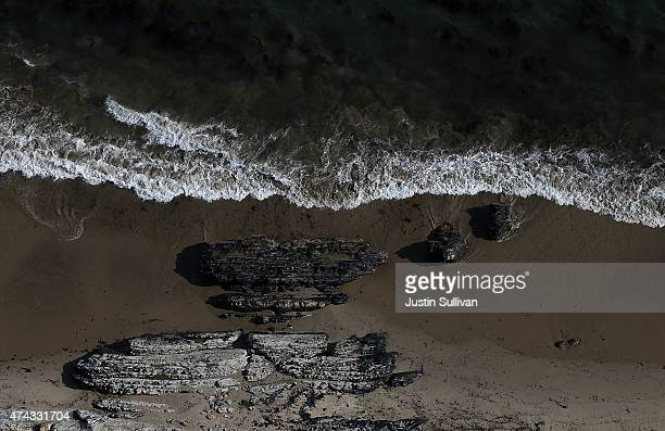 Oil is visible on on rocks near Refugio State Beach on May 21 2015 in Goleta California California Gov Jerry Brown declared a State of Emergency...