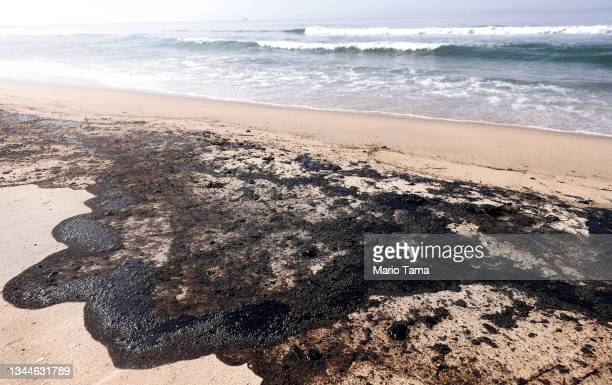 Oil is washed up on Huntington State Beach after a 126,000-gallon oil spill from an offshore oil platform on October 3, 2021 in Huntington Beach,...