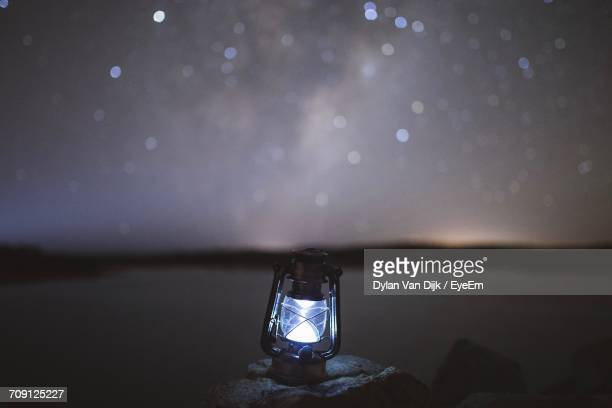 oil lamp against sky at night - oil lamp stock pictures, royalty-free photos & images