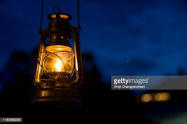 oil lamp lighting up the darkness or burning kerosene lamp background, camping  light concept - ランタン ストックフォトと画像