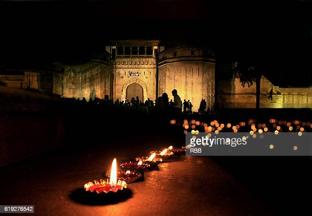oil lamps at shaniwarwada pune - diwali celebration stock photos and pictures