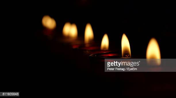 Oil lamps burning in row