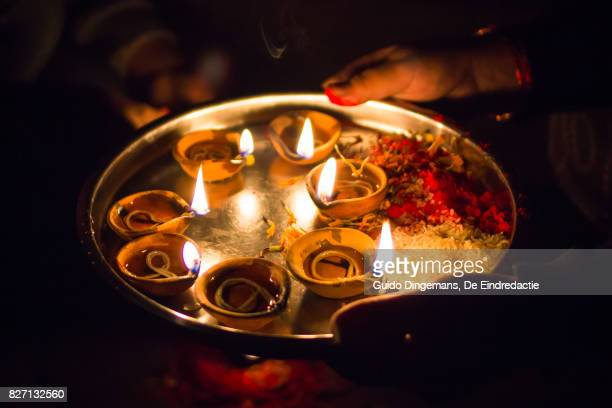oil lamps during lakshmi puja, festival of lights (kathmandu, nepal) - mystic goddess stock photos and pictures