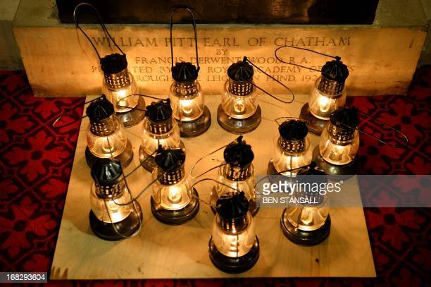 Oil lamps lie at the base of a statue of William Pitt Earl of Chatham in the Prince's Chamber as Yeomen of the Guard prepare to conduct a ceremonial...
