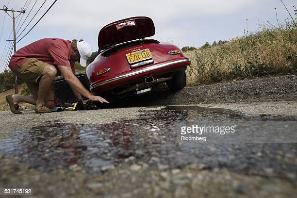 Oil leaks from a 1958 Porsche Speedster during the Friends of Steve McQueen Car Show Rally from Malibu to Santa Barbara California US on Saturday May...