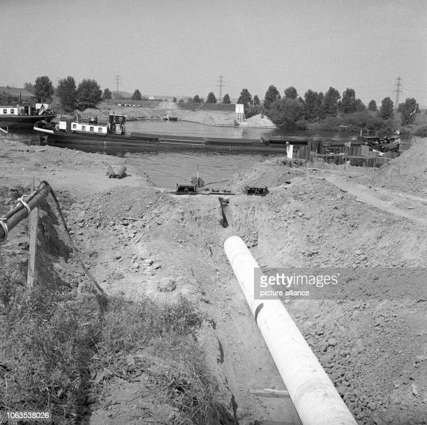 A oil line from the Dutch harbor Rotterdam to the new Caltex refinery near Frankfurt is laid through Main river on 30 July 1963 The picture shows the...