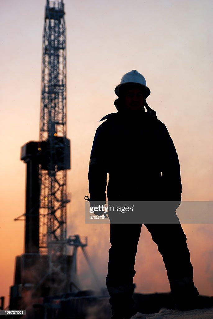 Oil man at dusk : Stock Photo