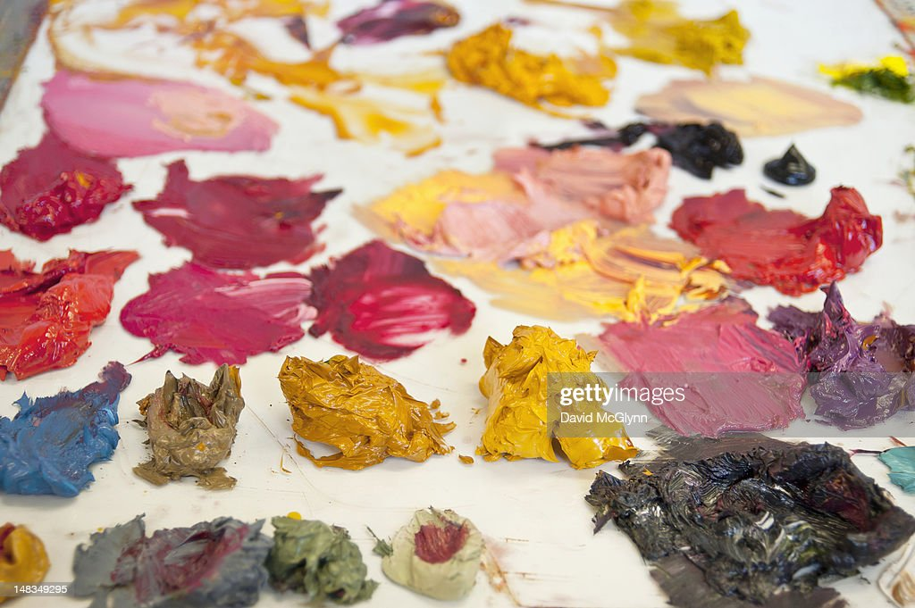 Oil paint on an artist's pallette : Stock Photo