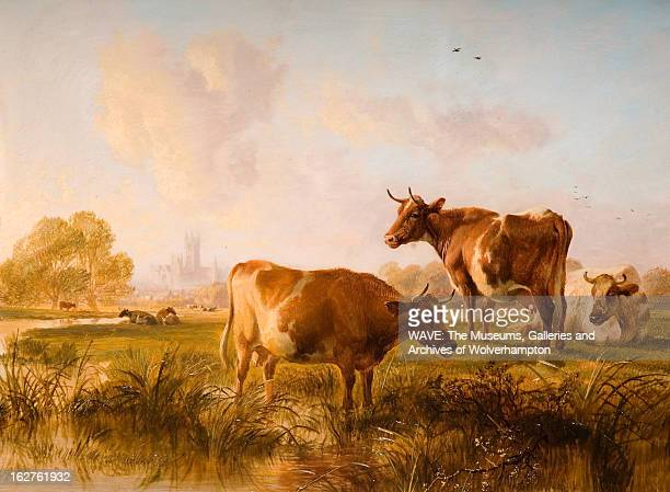 Oil painting showing a group of brown and cream cattle grazing on a meadow by a river In the distance the spires of Canterbury Cathedral can be seen...