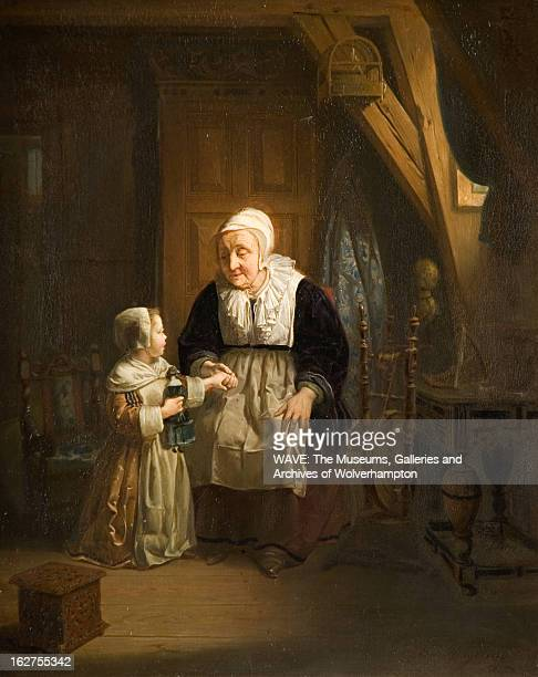 Oil painting showing a seated elderly woman, in a black dress with white overalls, holding the hand of a small child who is standing before her, The...