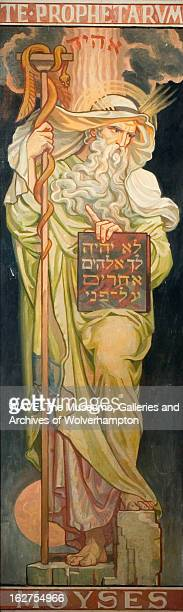 Oil painting showing an image of the prophet Moses The standing figure fills the canvas There is text at the top and bottom of the painting Stained...