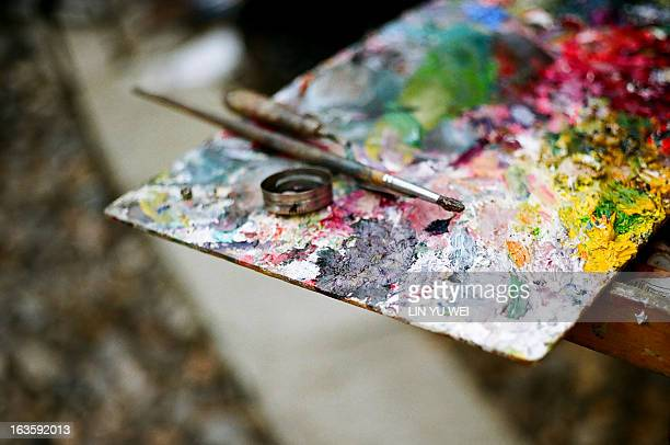 Oil palette and paintbrush