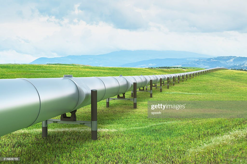 Oil pipeline in green landscape : Stock Photo