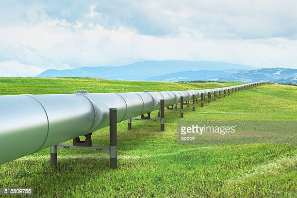 oil pipeline in green landscape - oil stock pictures, royalty-free photos & images