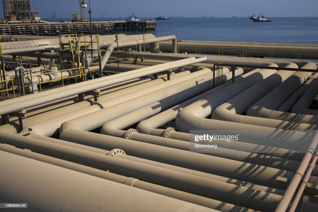 Oil pipelines sit on the quayside beside the Arabian Sea at the