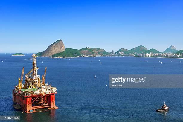 oil platform anchored in rio de janeiro - construction platform stock photos and pictures