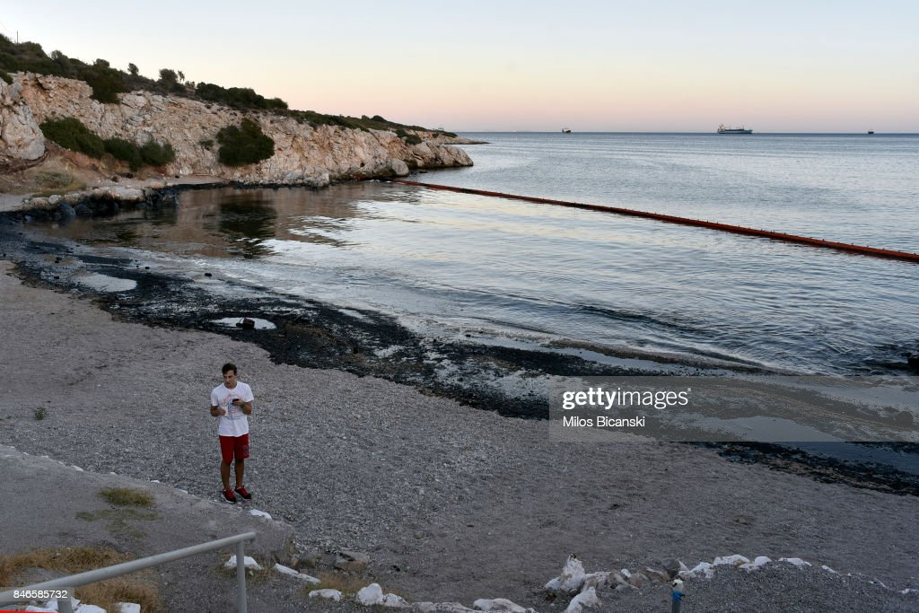 Oil pollutes a beach on the coast of Salamis Island on September 13, 2017 in Salamis, Greece. The small tanker 'Agia Zoni II' sank on September 10, whilst anchored off the coast of Salamis, near Greece's main port of Piraeus. It was carrying a cargo of 2,200 tons of fuel oil and 370 tons of marine gas oil. Salamis Island has suffered heavy pollution as a result in what has been called a 'major environmental disaster' by officials.
