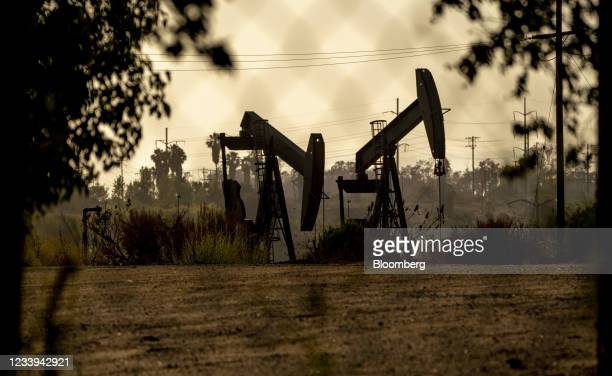 Oil pump jacks operate at the Inglewood Oil Field in Culver City, California, U.S., on Sunday, July 11, 2021. Oil dipped after a two-day gain as...