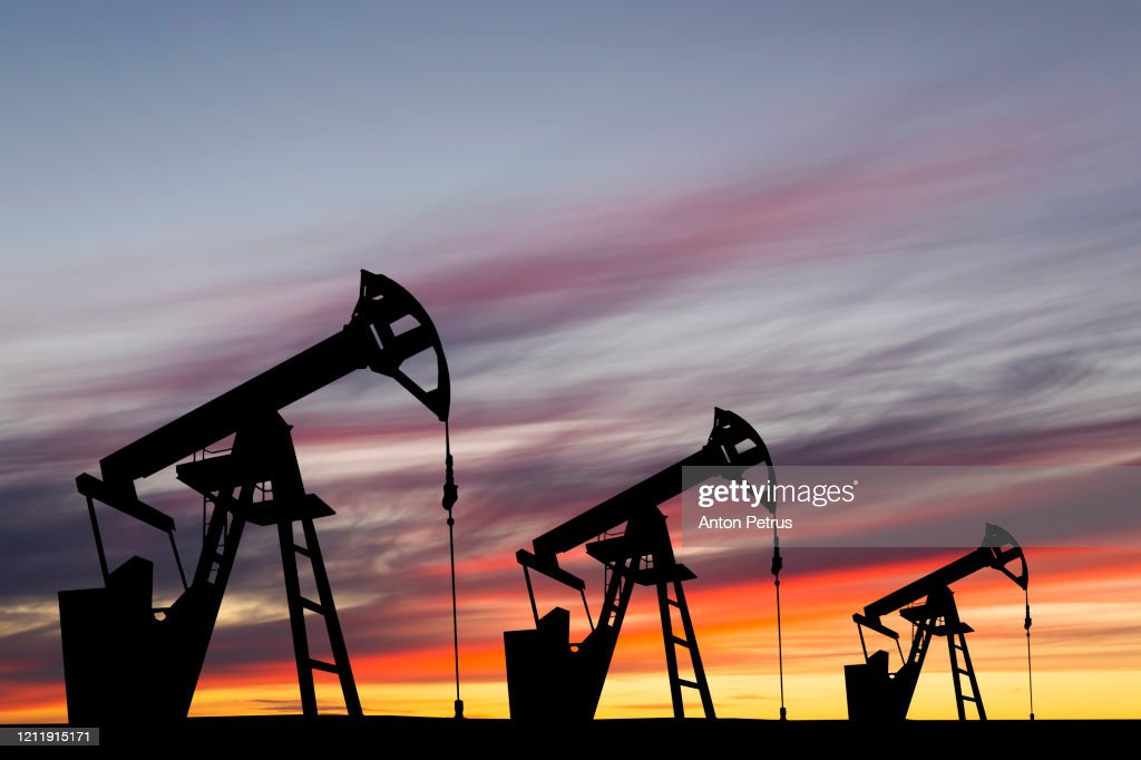 Oil pump on a sunset background. World Oil Industry : ストックフォト
