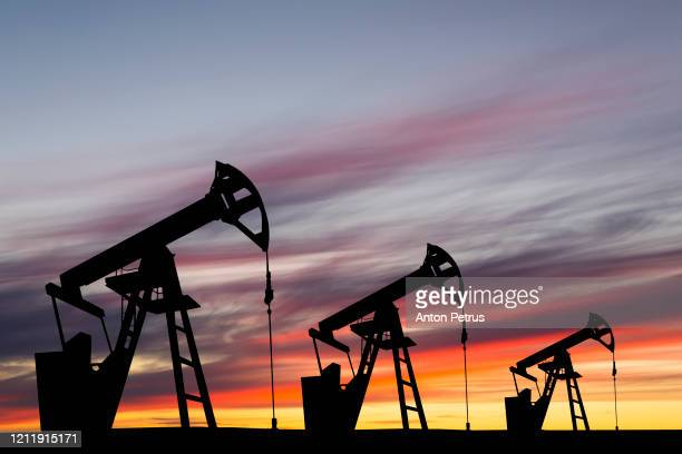 oil pump on a sunset background. world oil industry - motor oil stock pictures, royalty-free photos & images