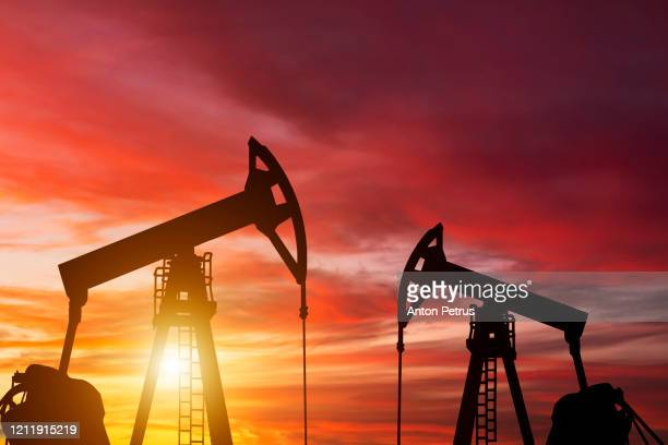 oil pump on a sunset background. world oil industry - crude oil stock pictures, royalty-free photos & images