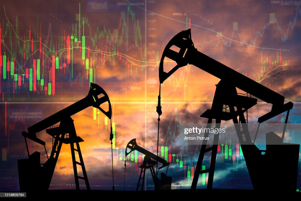 Oil pump with candle stick graph chart in the background. World Oil Industry : Stock Photo