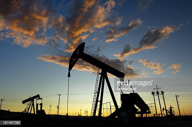 Oil Pumpjacks Against a Sunset Sky