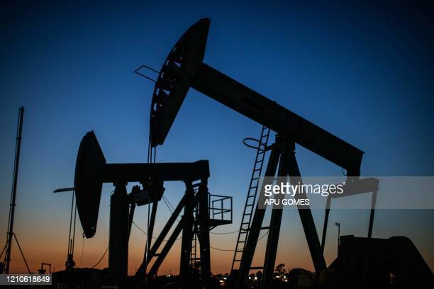 TOPSHOT Oil pumpjacks operate at dusk Willow Springs Park in Long Beach California on April 21 a day after oil prices dropped to below zero as the...